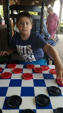 Wow! A hands-on, no charger required, fun game of checkers!